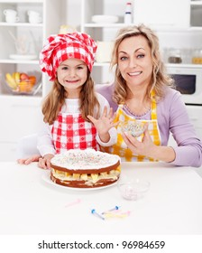 Making a cake for my birthday - little girl with mother in kitchen
