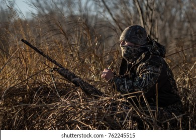 """Making the Call"" - On a freezing morning in Canada, a duck hunter prepares to call ducks."