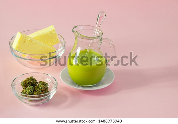 Making Cannabutter for Baking Edibles with Butter and Cannabis or CBD Hemp on Pink Background with Copy Space