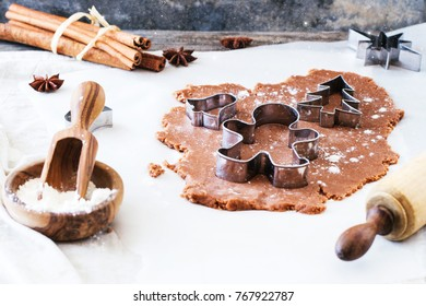 Making christmas cookies with cookie cutters and vintage rolling-pin