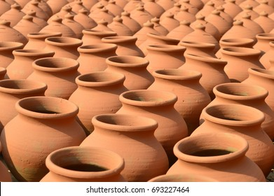 Making clay pot for storing drinking water and objects