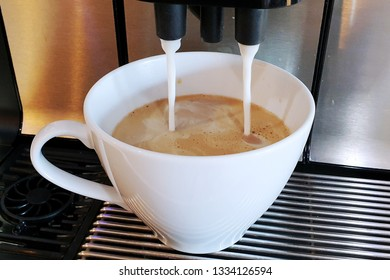 Making coffee from coffee machine, milk pouring from coffee machine