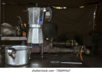 Making coffee on a camp stove