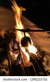 Making coffee over campfire during winter in Lapland.