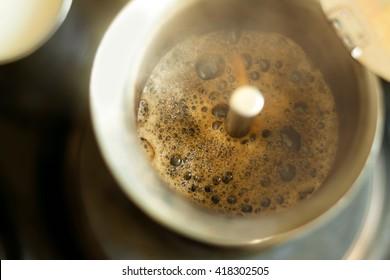 Making coffee using coffee makers geyser