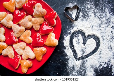 Making cookies in the form of hearts with tin models at home for Valentine's day.