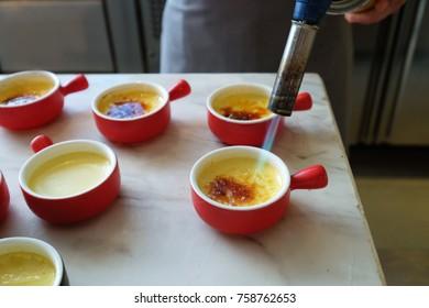 Making of creme brulee dessert