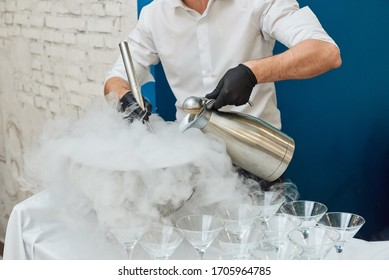 Making cryogenic ice cream handmade using liquid nitrogen and steam from dry ice. Concept chef cooking show. White smoke.