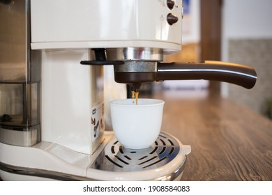 making cup of coffee in coffee maker