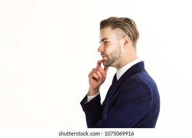 Making decisions concept. Man in suit or businessman with thoughtful face looks sharp isolated on white background, copy space. Young and handsome unshaven businessman touch his chin with index finger