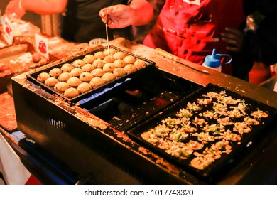 Making of the delicious homemade Japanese traditional food named TAKOYAKI (Octopus Dumplings) that cooking them on the Takoyaki steel hot oven.