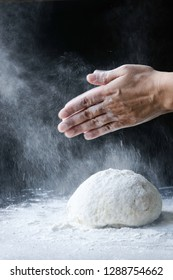 Making dough with flour by female hands