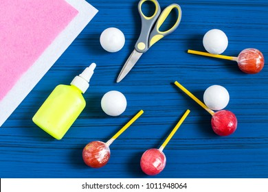 Making Easter bunny from lollipop. Sweet gift to children. Creative idea for children's party. DIY concept. Step by step photo instructions. Step 1. Preparation of materials and tools