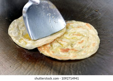 making eggs roti roll on hot metal pans with boiled vegetable oil. street food Food of Thailand