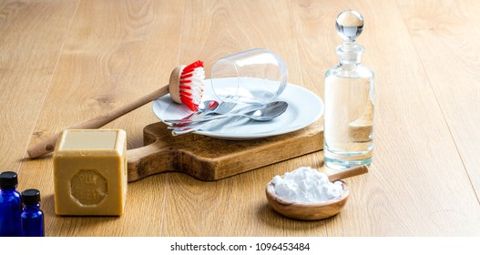 making environmentally friendly dish washing detergent with pure essential oils, healthy soap, biodegradable baking soda for DIY green cleaning