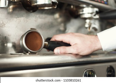 Making espresso and holding the grip right before the espresso is pressed.