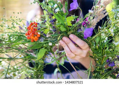 Making a Festive flower wreath,  circlet of flowers, making coronet of flowers on a bright sunny afternoon. Preparing for Midsummer night fest. How to Make a Flower Crown. Festival flower crown.