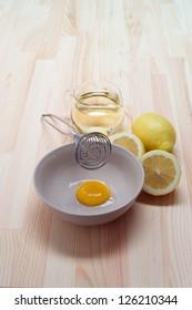 making fresh mayonnaise sauce on kitchen wood table