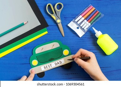 Making greeting card for Father's Day in shape of car. Children's art project. DIY concept. Step-by-step photo instruction. Step 9. Child makes inscription: Best Dad
