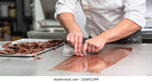 Making handmade chocolates. A confectioner making chocolate sweets. Close-up .