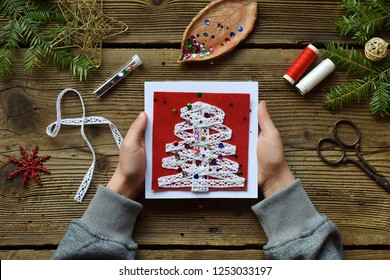 Making of handmade christmas greeting card from felt with your own hands. Children's DIY concept. Making xmas decoration