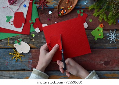 Making of handmade christmas toys from felt with your own hands. Children's DIY concept. Making xmas tree decoration or greeting card. Step 2. Cut the toy