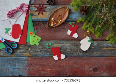 Making of handmade christmas toys from felt with your own hands. Children's DIY concept. Making xmas tree decoration or greeting card. Step 4. The finished toy