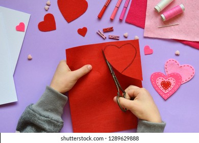Making of handmade Valentine greeting card from felt. Children's DIY, hobby concept, gift with your own hands. Valentine's Day decoration. Step 2. Cut the heart template