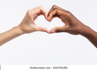 Making heart. Close up of diverse women with different skin color making heart out of hands