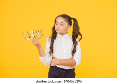 Making her prom look super special. A future prom queen. Cute small child holding golden crown for school prom on yellow background. Adorable little girl going to prom night.