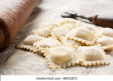 Making homemade ravioli with a wooden roller