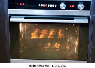 Making hot cross buns on good friday at Easter. The buns are in an oven baking