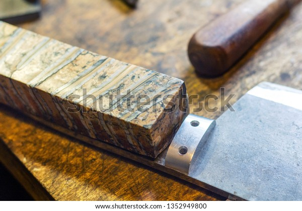 Making Mammoth Stabilized Tooth Tusk Knife Stock Photo (Edit