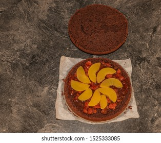 Making of marijuana brown cake with peach and strawberry fruit and cannabis green leaf