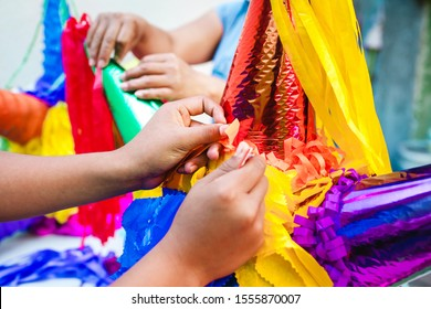 Making a Mexican Pinatas handmade by Mexican artisans for posadas in Christmas in Mexico