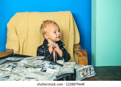 Making money decisions. Little entrepreneur work in office. Boy child with money case. Little boy count money in cash. Small child do business accounting in startup company. Startup business costs.