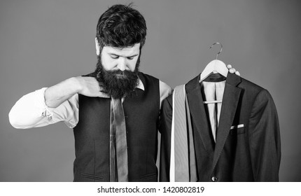 Making necessary purchase. Bearded man buying fashion purchase in mens store department. Businessman choosing among broad assortment of neckties to purchase. His personal purchase.