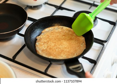 Making Pancakes on frying pan. Making Crepes on frying pan.