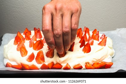 Making of pavlova cake, at closeup towards gray concrete wall