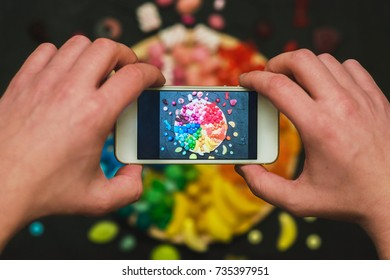 Making photo of colorful candies on smartphone