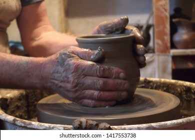 making a pot on potter's wheel