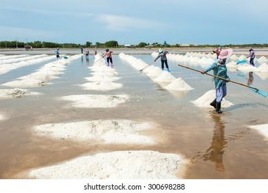 Making pyramid of salt,Thailand.