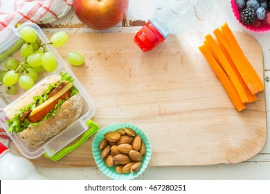 Making school lunch on wood background