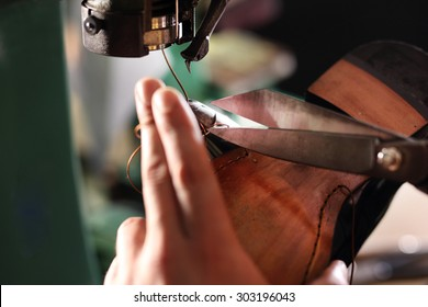 Making shoes. Sewing machine. shoemaker sews shoes.