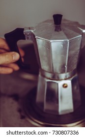 Making slow coffee with perculator for daily caffeine