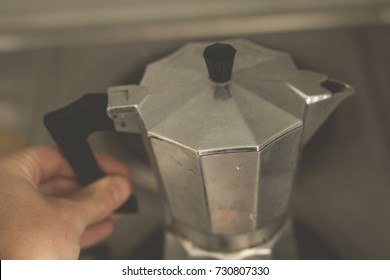 Making slow coffee with steamy perculator for daily caffeine