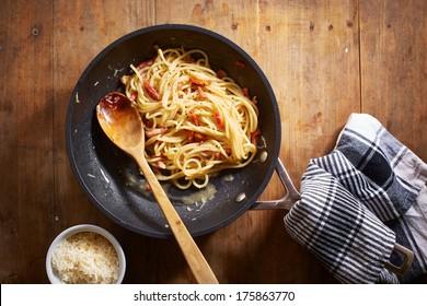 Making spaghetti a la carbonara overlook shot