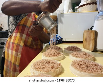 The making of string hoppers, a popular food in Sri Lanka and India.