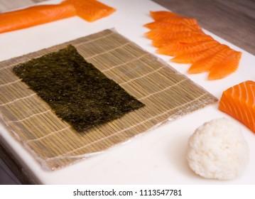 Making sushi rolls. Sushi master, cutting sushi rolls.