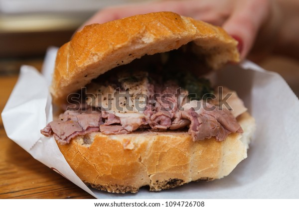 Making of traditional lampredotto sandwich in Florence, Italy. Lampredotto is a typical Florentine dish made from the stomach of a cow